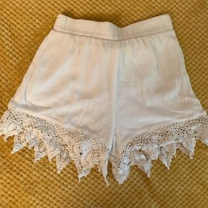 White shorts with a cute pattern at the bottom